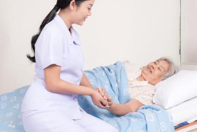 a photo of a nurse checking her patient